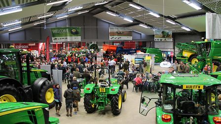 Farm machinery on display at a show.