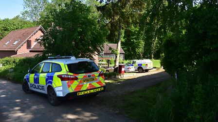 Police at the property belonging to Peter and Sylvia Stuart. Peter's body was discovered in woods a