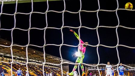 George Elokobi (hidden) shoots over Wycombe keeper Jamal Blackman to secure a 1-0 win for the U's in