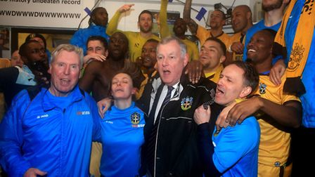 Sutton United celebrate in the dressing room after beating Leeds yesterday