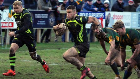 Sam Sterling breaks through to score one of his two tries in the second half of Bury's 27-21 home de