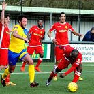 AFC Sudbury's James Baker tries to make space in the Merstham area