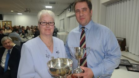 Rita Parker collecting the Olivers Perpetual Trophy for the Champion Beast from Stanfords partner C