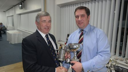 Gerald Ketley collecting the award from Stanfords partner Chris Leney for Champion Sheep on behalf