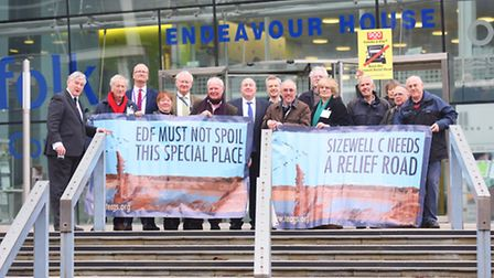 Protest group members and Suffolk county councillors pictured outside Endeavour House before Suffo