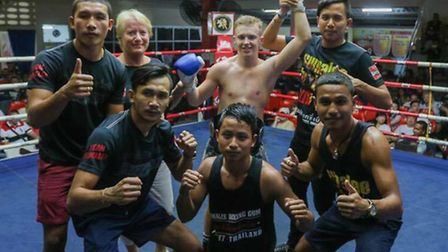 Joe Le Maire celebrates his Patong Stadium title belt win with the Sumalee team