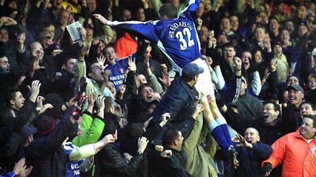 50- Hermann Hreidarsson dives into the North Stand crowd after believing he had scored for Ipswich T