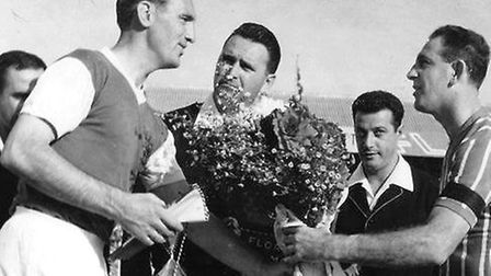 45 - Andy Nelson exchanges tokens and flowers with Floriana captain Pullu DEmanuele.