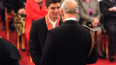 England cricket captain Alastair Cook is awarded an CBE by the Prince of Wales during an investiture