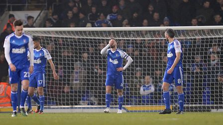 Luke Chambers holds his head after Derby County's second goal