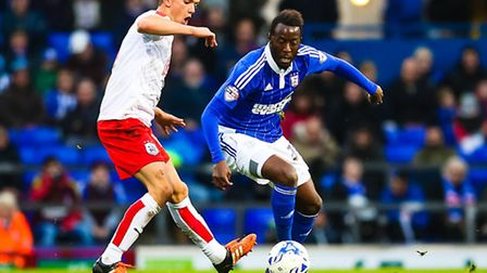 Larsen Toure battles with Emyr Huws during the Ipswich Town v Huddersfield Town (Championship) matc