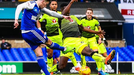 Tom Lawrence fires towards goal but his shot is blocked by Reading's Tyler Blackett during the firs