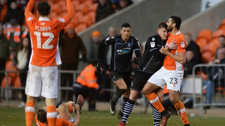 Sean Murray tangles with Blackpool substitute Colin Daniel after his bad foul on Jim McAlister. Murr