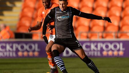 Matt Briggs shields the ball from Blackpool's Jamille Matt during his return to first-team action at