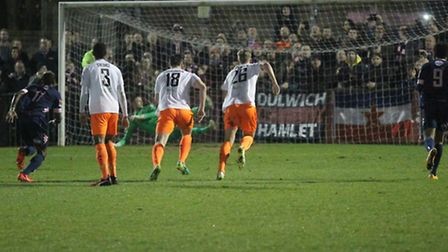 Braintree keeper Sam Beasant dives the wrong way as Ashley Carew (not in picture) slots home a first