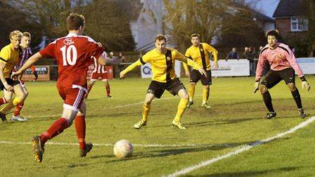 Felixstowe's Jordan Matthews sets up the advancing Tom Winter to score for the Seasiders in a top-of