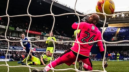 Reading keeper Ali Al-Habsi is helpless as Tom Lawrence's shot cannons down off the underside of the