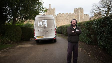 Rick Minns in front of Framlingham Castle, with the picture on his van inspired by Ed Sheeran and th