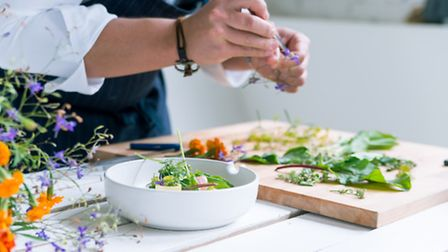 A chef prepares a meal (stock images)