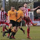Felixstowe's Miles Powell is too strong for the Fakenham rearguard