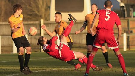 Felixstowe's Craig Jennings acrobatically connects to score his second goal at Fakenham on Saturday