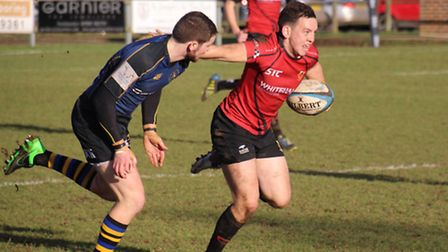 Colchester scrum half and man of the match Brett Cutbush breaks with the ball at Hertford
