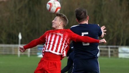 Hadleigh United v Newmarket Town. Newmarket's Lewis Whitehead wins a header.
