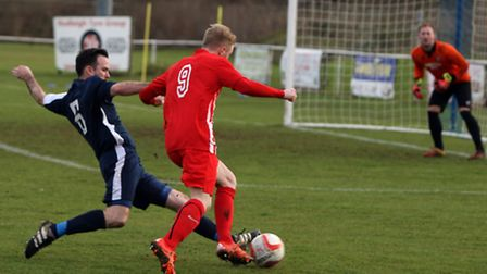 Hadleigh United v Newmarket Town. Newmarket's Lewis Whitehead tries to go past Hadleigh's Ben Elliot