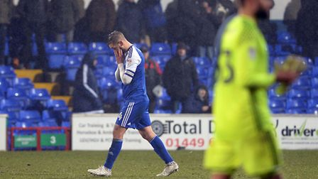 Luke Chambers holds his head in his hands after the 3-0 defeat by Derby