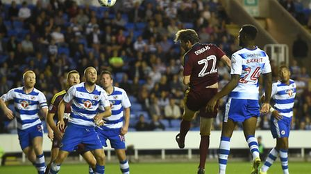 Jonathan Douglas heads at the keeper during a game at Reading