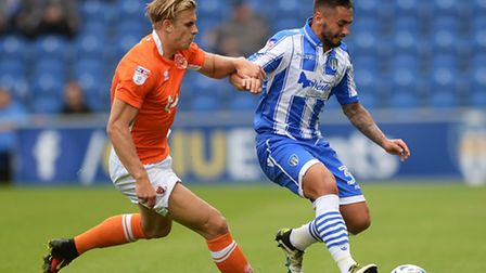 Lewis Kinsella, on the ball against Blackpool's Brad Potts during the U's 3-2 home win. Kinsella is
