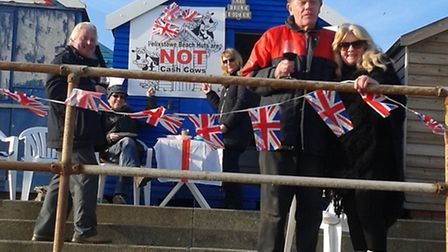 Hut owners at at Felixstowe with their Beach Huts are Not Cash Cows poster