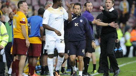 Daniel Pappoe has to walk past irate Bradford boss Phil Parkinson after being sent off for a late ch