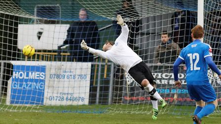 Leiston 'keeper Nick Eyre is beaten by Tom Tejan-Sie for Wingate's second goal