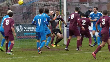 Joe Francis, iin blue shirt far right, watches his shot enter the net for a consolation goal for Lei