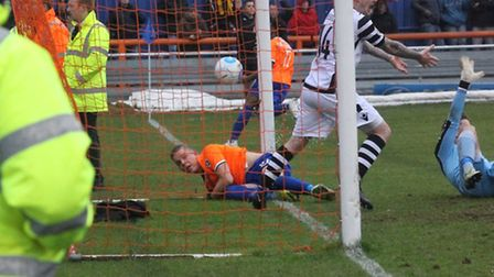 Braintree's Monty Patterson bundles the ball into the net, but note the linesman�'s flag: no goal! I