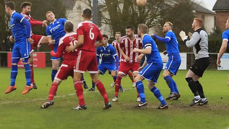Rhys Barber (left) heads home the equaliser for the Seasiders