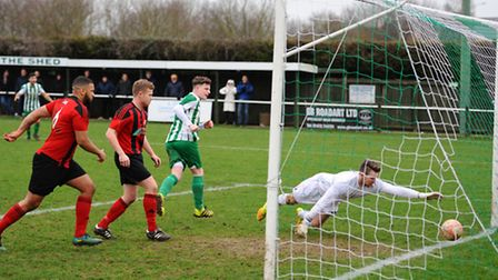 Lewis Bell scores the opening goal for Whitton against Coggeshall on Saturday