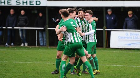 Lewis Bell (right) celebrates scoring the opening goal for Whitton against Coggeshall. Picture: Ashl