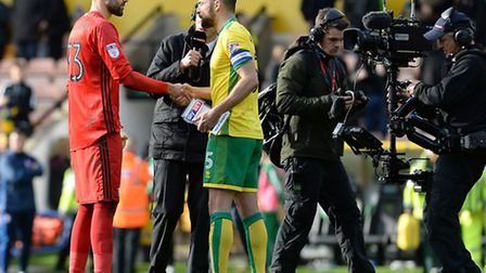 Bartosz Bialkowski gets his Man of the Match award from Norwich Captain Russell Martin at Carrow Roa