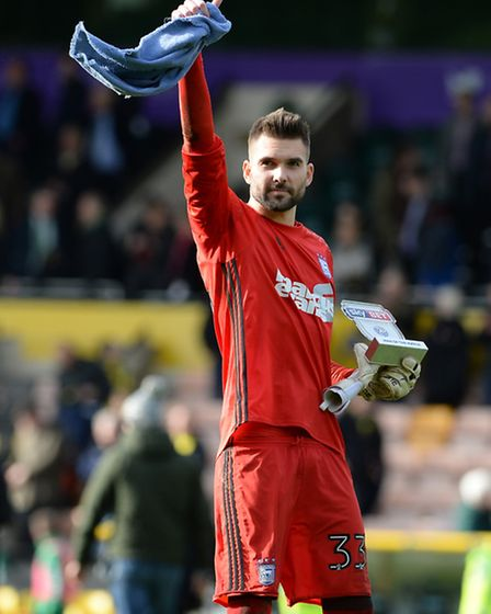 Ipswich Derby Day hero Bartosz Bialkowski salutes the fans at Carrow Road