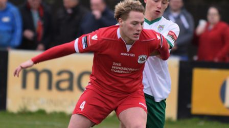 Needham's new signing Cameron Norman on the ball on Saturday