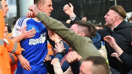 Jonas Knudsen celebrates with the travelling fans after giving Ipswich the lead with this second hal