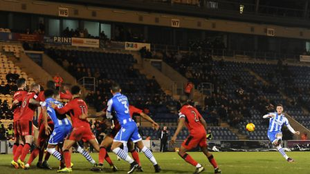 Ben Dickenson of Colchester United scores his side's second goal to make the scoreline 2-3.