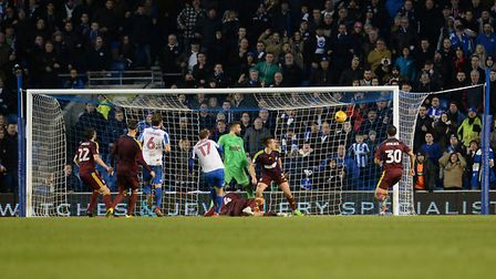 Ipswich survive at Brighton as Glen Murray's shot hits the inside of the post and goes clear