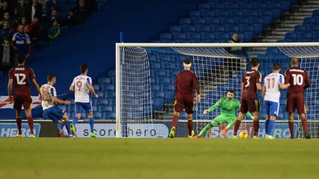 Bartosz Bialkowski is beaten from the penalty spot for Brighton's first half equaliser