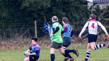 Libby Stopard crosses for the Woodbridge Amazons