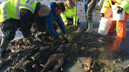 Members of the CITiZAN team lifting at timbers discovered at Mersea Island. Picture: CITiZAN