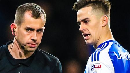 Tom Lawrence has words with referee, Peter Bankes, during Town's game with Nottingham Forest earlier