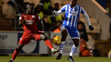 Tariqe Fosu of Colchester United does battles with Aliu Djalo of Crawley Town.